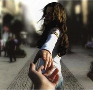 Hands separating in goodbye